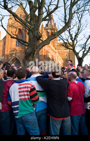 dh The Ba KIRKWALL ORKNEY Pack of Ba players St Magnus Cathedral christmas day ball game Scotland - Stock Photo