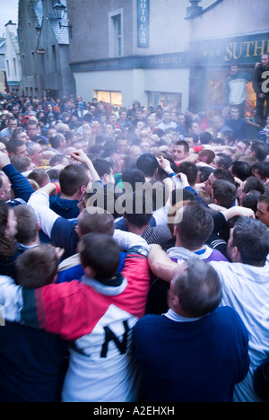 dh The Ba KIRKWALL ORKNEY Pack of Ba players Victoria Street   New Years day - Stock Photo