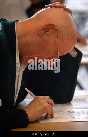 A CONTESTANT AT THE TIMES NATIONAL CROSSWORD COMPETITION CUP DURING THE CHAMPIONSHIPS IN CHELTENHAM UK 2006