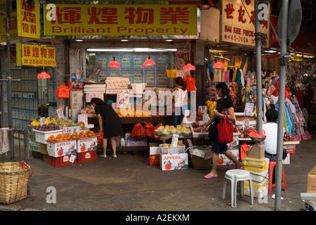 dh Chun Yeung Street Market NORTH POINT HONG KONG Customers looking at greengrocers stall of fresh fruit - Stock Photo