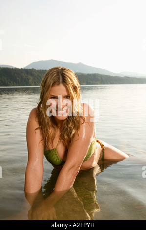 Woman bathing in lake - Stock Photo