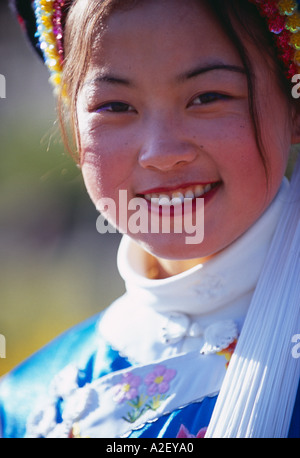 local Bai woman in traditional costume Dali Yunnan Province China - Stock Photo