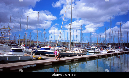 Boats moored in the harbour at Lagos Marina in the Algarve in south west Portugal - Stock Photo