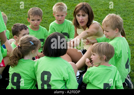 Coach giving strategy to soccer team age 28 and 5. Carondelet Field by Expo School St Paul Minnesota USA - Stock Photo