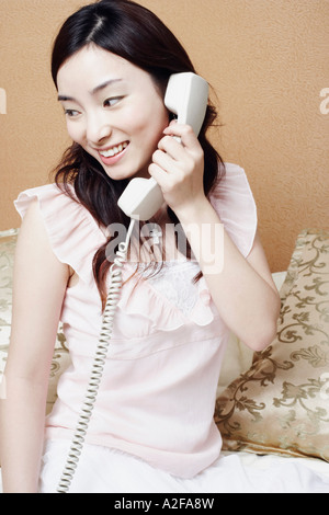 Young woman talking on the telephone - Stock Photo