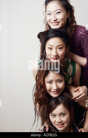 Portrait of three young women and a teenage girl - Stock Photo