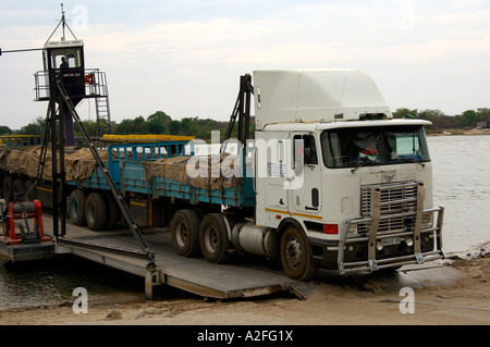 Truck from South Africa is disembarking from a ferry between Botswana and Zambia, Kazungula, border station Botswana - Stock Photo