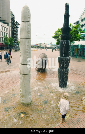unknown child plays in fountain in anker brygge, Oslo Norway - Stock Photo