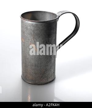 Old tin cup, close-up - Stock Photo