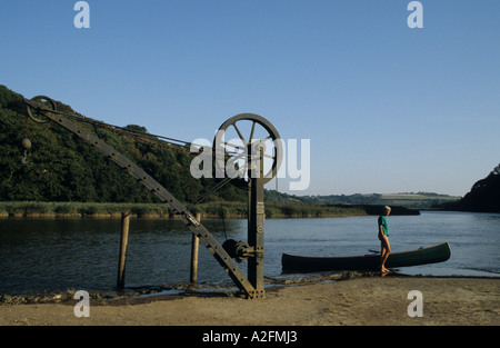 Canoe and old victorian crane at Cotehele Quay Key on the Tamar at Cotehele Cornwall UK Britain - Stock Photo