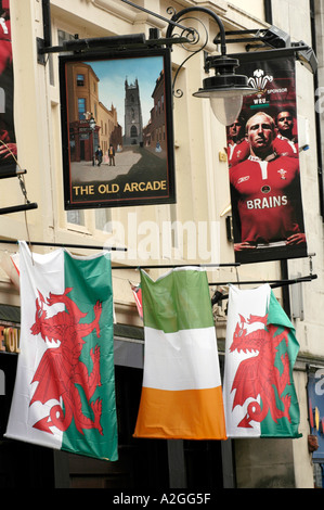 Welsh and Irish flags hanging outside The Old Arcade pub on a rugby international weekend in Cardiff city centre - Stock Photo
