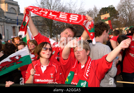 Welsh women rugby fans on street in Cardiff city centre celebrating Wales winning and international match - Stock Photo