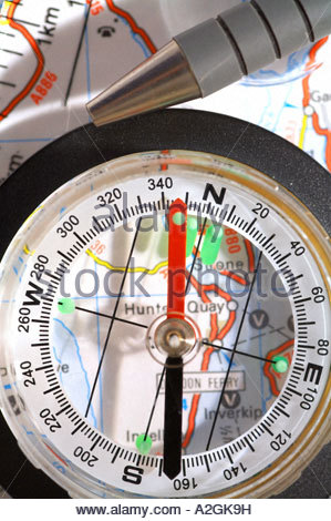 Compass, map and pen - Stock Photo