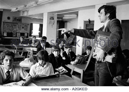 Secondary school teacher trying to control the classroom - Stock Photo