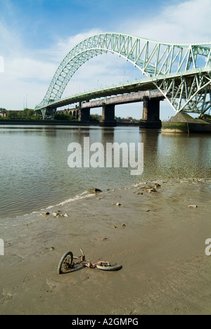Runcorn Widnes Bridge spanning the River Mersey in Cheshire with debris in the foreground. - Stock Photo