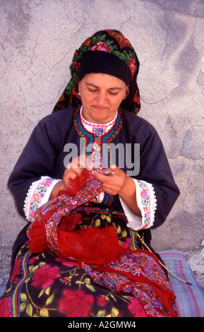 Greece Dodecanese Islands Karpathos A woman from Olympos Village doing Embroidery - Stock Photo