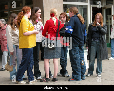 teenage girls hanging out in a shopping centre - Stock Photo