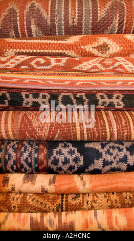 Stack of Indonesian ikat decorated fabrics from Flores Sulawesi Kalimantan Timor Sumba INDONESIA - Stock Photo