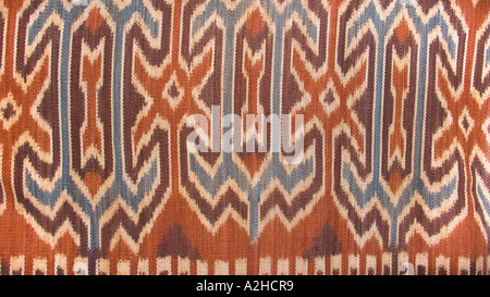 Detail of geometric motifs on hipstrap loom woven ikat decorated shawl from Tana Toraja Central Sulawesi Indonesia - Stock Photo