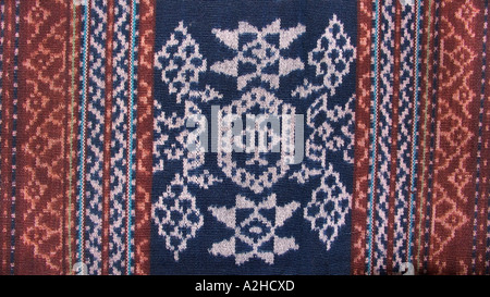 Detail of stylised floral motif on hipstrap loom woven ikat decorated shawl from Timor Indonesia - Stock Photo