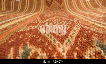 Detail of geometric motif on hipstrap loom woven ikat decorated shawl from Timor Indonesia - Stock Photo