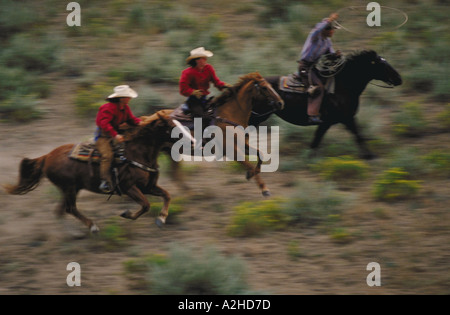 Cowboys Riding Horses Hard And Fast Through Town With Six
