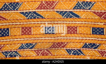 Detail of silk brocaded geometric motifs on hipstrap loom woven cloth from southern Sumatra Indonesia Tampan cloth - Stock Photo