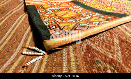 Detail of geometric motif and beadwork tassels on hipstrap loom woven ikat decorated skirt from Timor Indonesia - Stock Photo