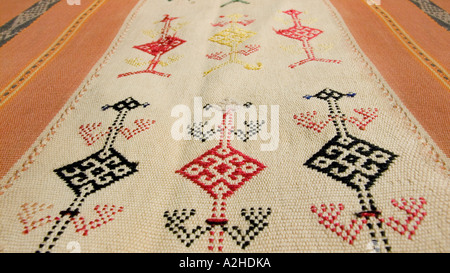 Detail of zoomorphic supplementary weft brocaded motif on hipstrap loom woven shawl from Timor Indonesia - Stock Photo