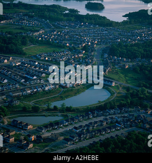 An aerial oblique view of a sprawl of suburban houses near a lake Kitchner Ontario Canada - Stock Photo