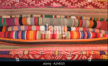 Stack of Andean fabrics from Peru and Bolivia As sold in the markets of La Paz Bolivia and Cuzco Pisac Peru - Stock Photo