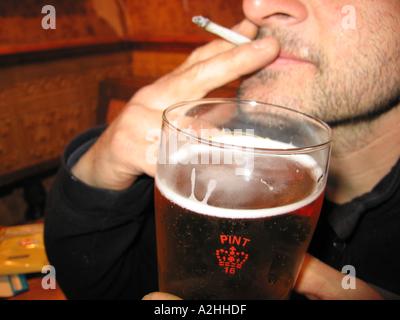smoking roll up tobacco bath u k - Stock Photo