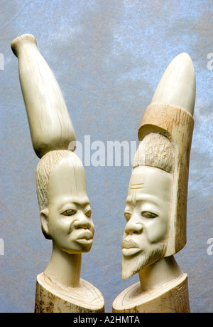 Carved ivory figurines of a stylised African man and woman. DSC 8188 - Stock Photo