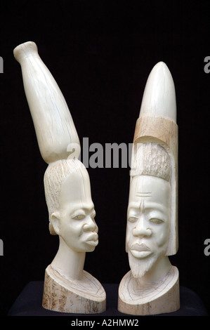 Carved ivory figurines of a stylised African man and woman. DSC 8190 - Stock Photo