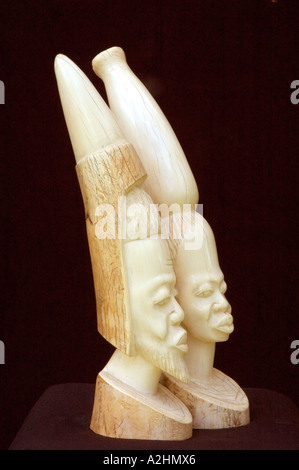 Carved ivory figurines of a stylised African man and woman. DSC 8195 - Stock Photo