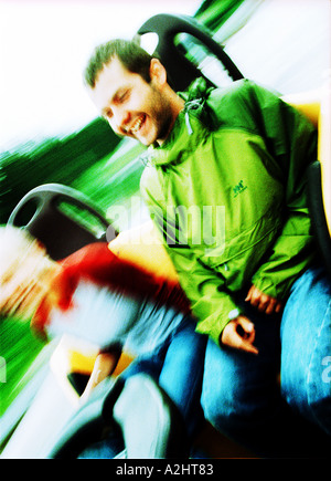 Male and female age 20-25 having fun at the fun fair. - Stock Photo