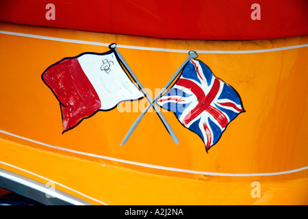 Flags of Malta and UK painted on front of a Traditional Bedford Bus Valletta Malta - Stock Photo