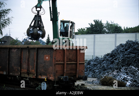 Scrap metal for recycling being loaded onto a train in Solingen, North Rhine-Westphalia, Germany. - Stock Photo