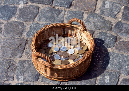 Belgium Brussels Old Town Buskers Basket with Coins - Stock Photo