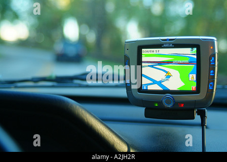 global positioning satellite (gps) unit being held in a