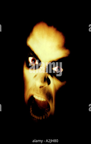 demonic face of a man. - Stock Photo
