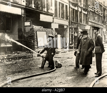 WINSTON CHURCHILL inspects bomb damage on Ludgate Hill, London, after a German air raid in October 1940. See Description - Stock Photo