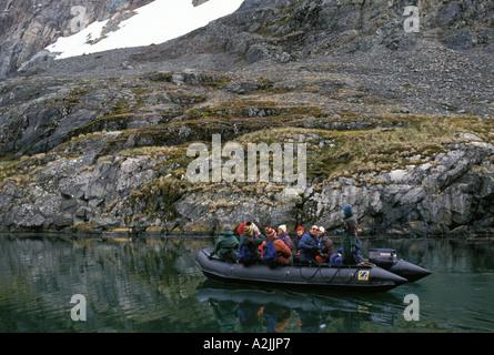 Antarctica, Sub-Antarctic Islands, South Georgia. Tourists exploring in zodiac - Stock Photo
