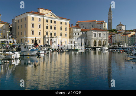fishing boats in the harbor of the historic center of Piran - Stock Photo