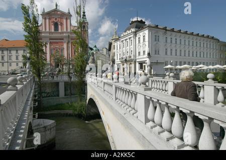 stone bridge over the Ljubljanica river in the historic center of Ljubljana - Stock Photo
