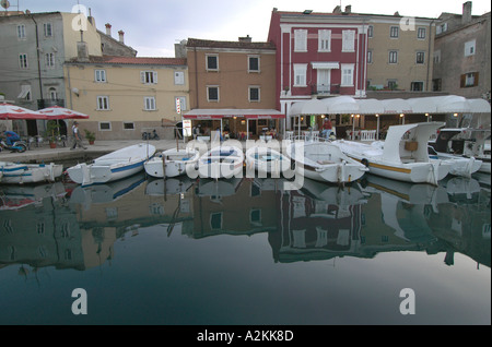 fishingboats in the harbor of the historic center of Cres - Stock Photo