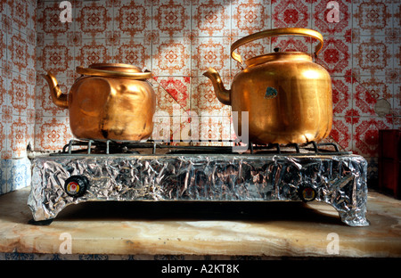 Stove with a couple of teapots in the kitchen of the Golestan Inn guesthouse in the Iranian town of Kashan. - Stock Photo