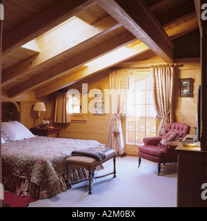 A bedroom with skylight window in a traditional chalet in Switzerland - Stock Photo