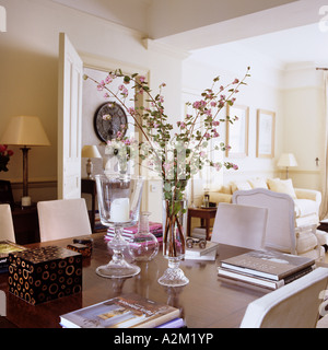 Books and flower arrangement on table in neoclassical style drawing room. - Stock Photo