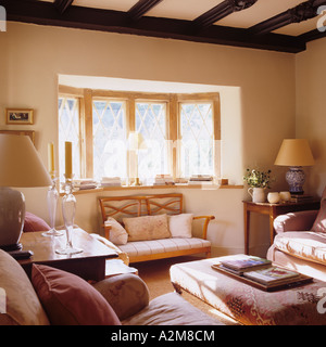 Cosy sitting room with bay window and beamed ceiling in converted Victorian Gloucestershire cottage - Stock Photo